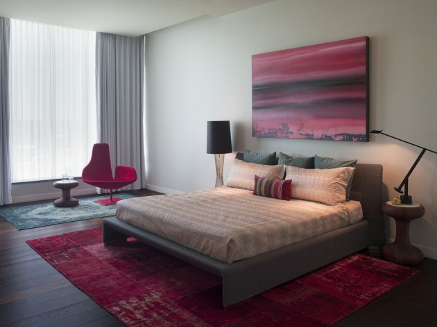 Modern bedroom with red rug