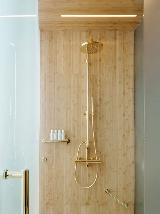 Gold and wood bathroom decor