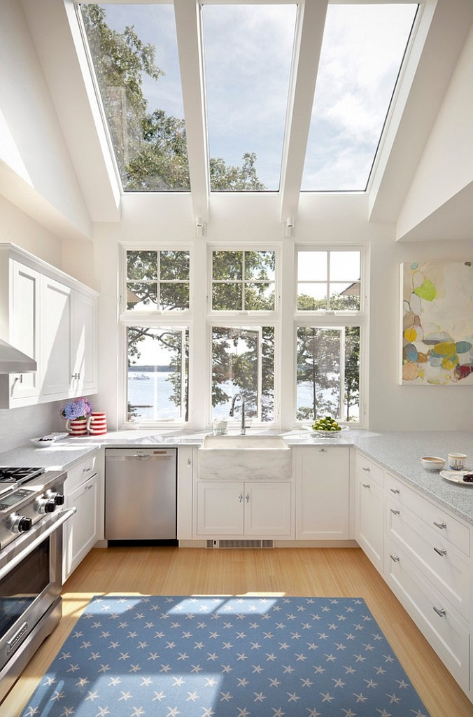 Luxury and bright kitchen in white opens up towards the view outside