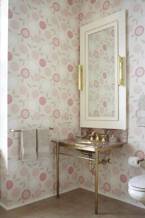 Pink bathroom walls and gold details