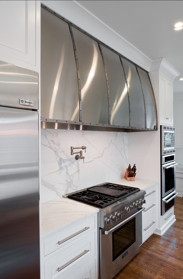 There are lots of Stainless steel elements in this kitchen, Designed by Andrew Roby General Contractors.