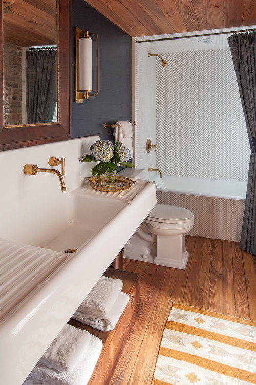 traditional bathroom with gold color metal fixtures