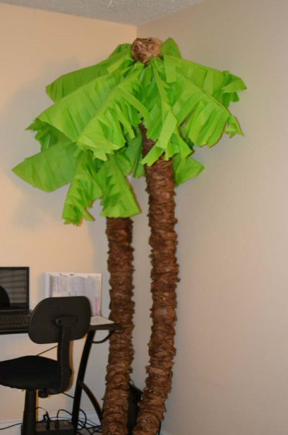 You can make your own palm trees with pool noodles